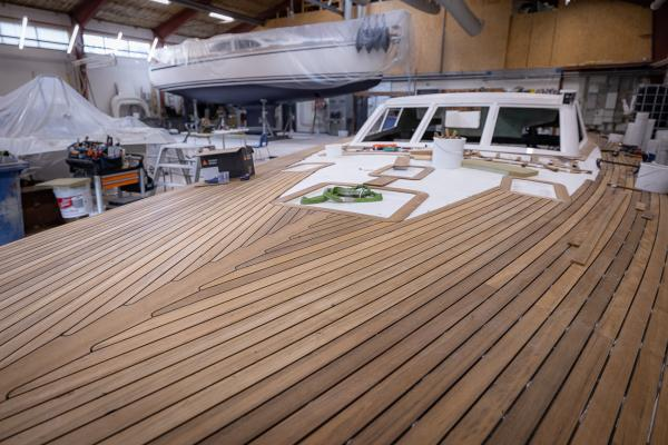 Teak is mounted by hand on the Nordship 570 DS deck