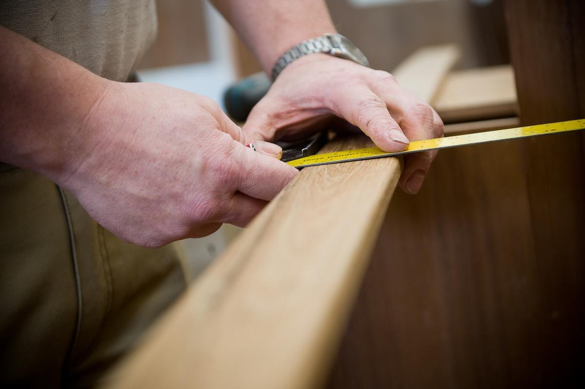 Nordship craftsman doing precision measurement